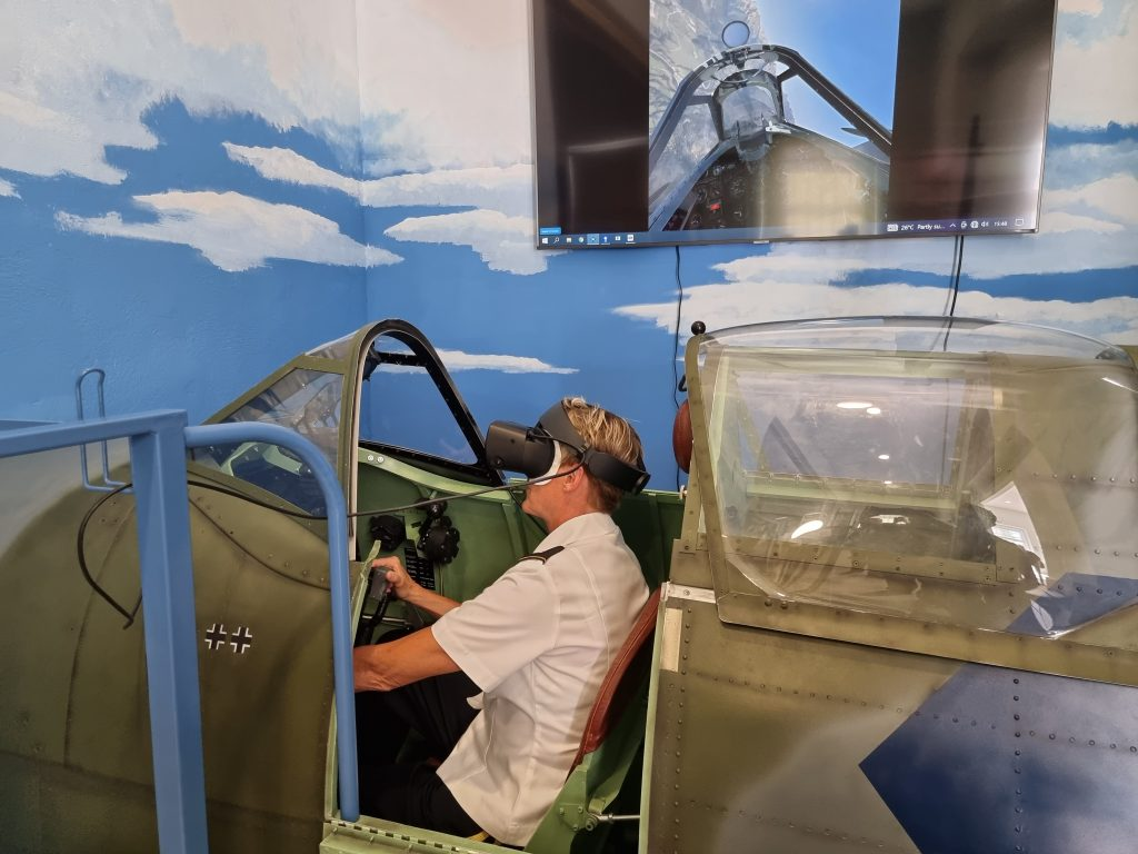 """Colorado National Guard Commander Brigadier Laura Clellan flew the simulator at Park of Military History opened the supplement to the exhibition """"TO HELL AND BACK"""" - the story of American planes that fell during the Second World War in Slovenia."""