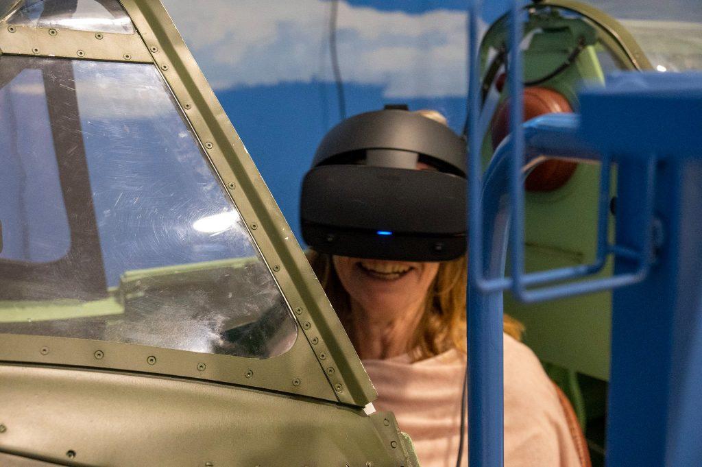 UK Ambassador to Slovenia, Her Excellency Tiffany Sadler flies the Spitfire simulator in Pivka Militarz History.